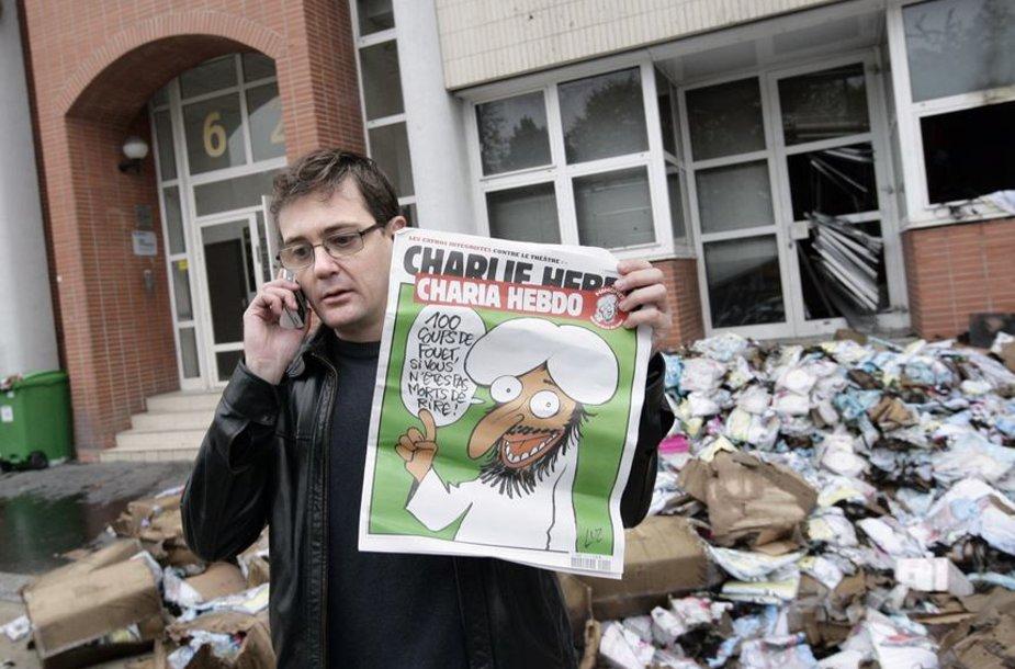 Ant žurnalo viršelio spausdinama pranašo Mohamedo karikatūra.