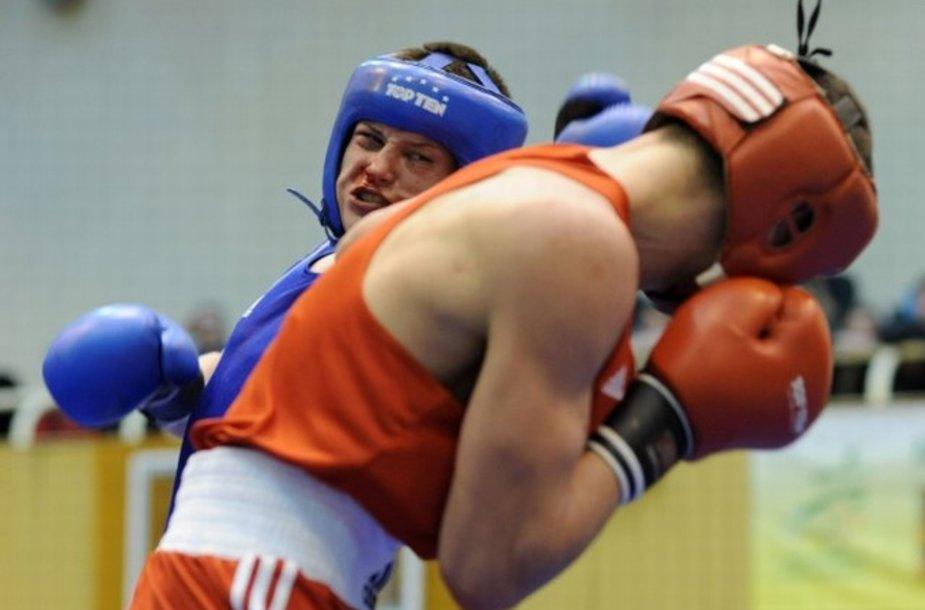 Eimantas Stanionis (mėlyna apranga) tapo čempionu svorio kategorijoje iki 64 kg.
